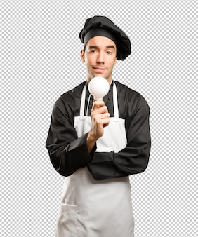 Pojęcie młodego szefa kuchni mających pomysł
