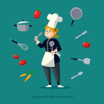 Ładny szef kuchni ze składnikami i naczyniami do gotowania naokoło