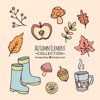 Asortyment ręcznie rysowanych elementów jesiennych