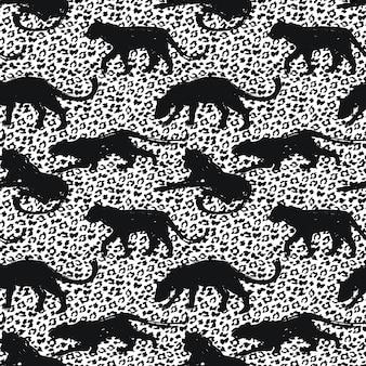 Bezproblemowa egzotyczny wzór z abstrakcyjnymi sylwetkami zwierząt.