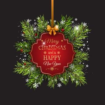 Boże Narodzenie w tle z jodłowych gałęzi drzew i wstążką ozdobną etykietą