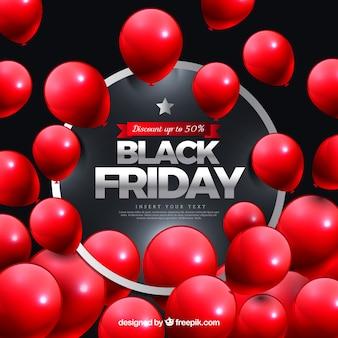 Czarny piątek z czerwonymi realistycznymi balonami