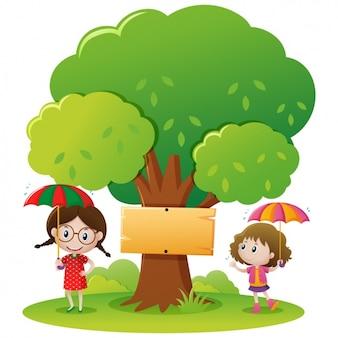 Dziewczynki bawiące się pod drzewem