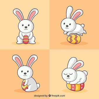 Hand wyciągnąć królika z jajkiem wielkanocnym