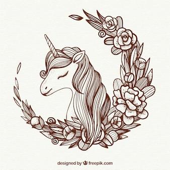 Jednorożec ilustracji tła i kwiatów wieniec