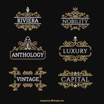 Kolekcja ozdobnych złote logo