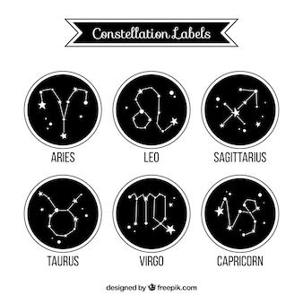 Kolekcja zaokrąglonych czarnych etykiet z konstelacji