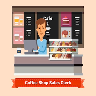 Młody asystent sklepu służąc filiżankę kawy
