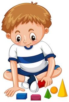 Mały chłopiec gra w kształty