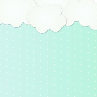 Niebieskie i zielone tło z chmurami