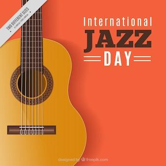 Pomarańczowe tło z gitara jazzowa