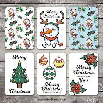 Różnorodność ręcznie rysowane kart świąt i szczęśliwego nowego roku