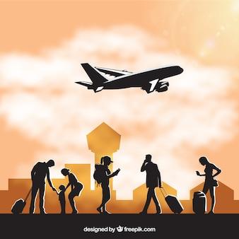 Sylwetki ludzi na lotnisku