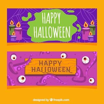 Szczęśliwe banery halloween w płaskim wzornictwie ze świecami i oczami