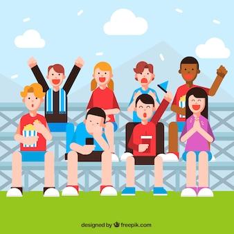 Tło młodych ludzi ogląda mecz