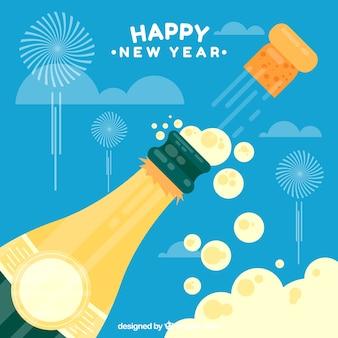 Tło nowego roku z butelką szampana