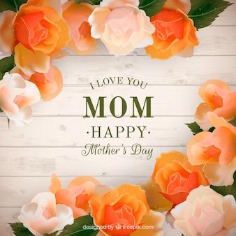 Tło z desek z realistycznymi kwiatów na dzień matki