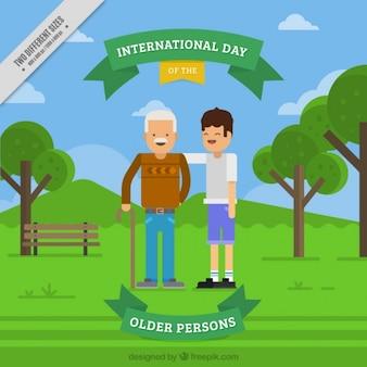 Wnuk obchodzi ze swoim dziadkiem dzień starszych osób