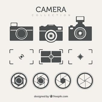 Zestaw aparatów fotograficznych i innych elementów w stylu retro