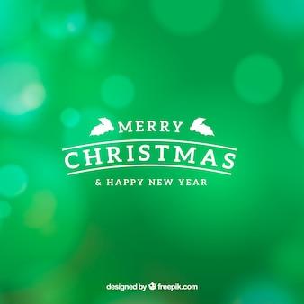 Zielony bokeh Boże Narodzenie w tle
