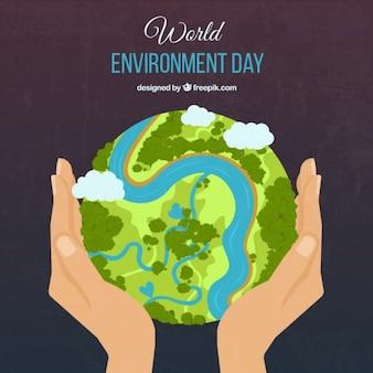 Zielony ziemi i ręce tle