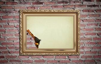 Archiwalne ramki złota spalony na tle ściany