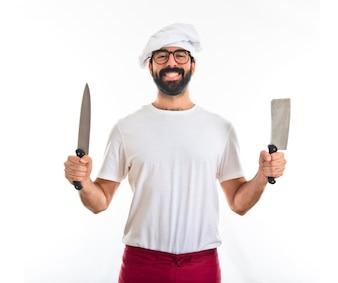 Chef trzyma noże