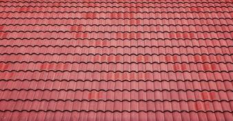 Czerwone dachówki dachowe tle