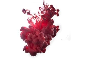 Czerwony atrament w wodzie