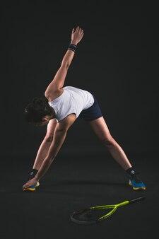 Fit graczem rozciągając jej ciało