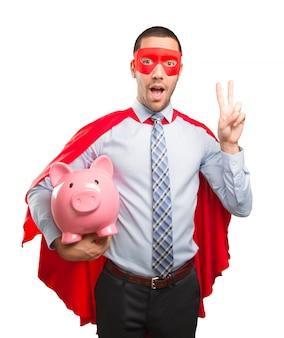 Koncepcja oszczędzania super biznesmen z Skarbonka
