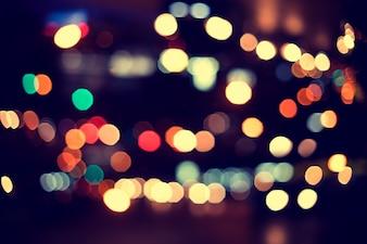 Oświetlenie świąteczne. Rozmyte tło bokeh z christmas party nocy dla projektu, zabytkowe lub retro kolor stonowanych