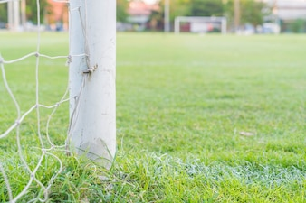 Piłka nożna cel piłki nożnej trawa zielona dziedzinie