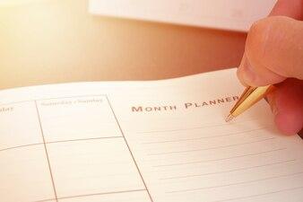 Ręcznie pisania puste planowania notebooka na biurko użyj organizator harmonogram życia lub koncepcji planner biznesowych