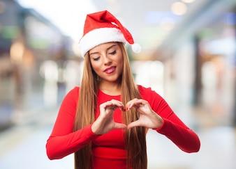 Romantyczna dziewczyna podejmowania symbol serca