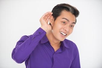 Uśmiecha Się Asian Man Catching Ręka Za Ucho