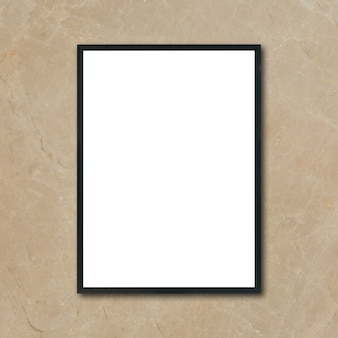 Zamontuj pustą ramkę plakatu wiszącą na ścianie brązowego marmuru w pomieszczeniu - można użyć makiety do wyświetlania produktów montażowych i projektowania kluczowych wizualnych układów.