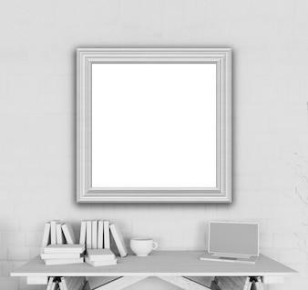 3d render de un marco de imagen en blanco en una oficina