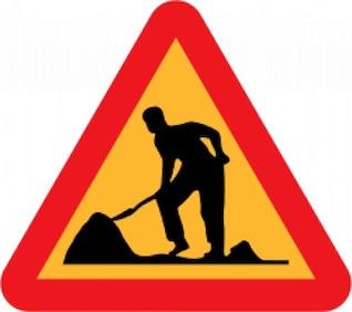 trabajador por delante roadsign