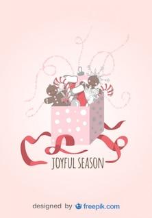 Tarjeta de felicitación de temporada alegre hecha de un regalo abierto con bastones de caramelo, calcetines  y muñecos de navidad