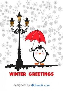 Tarjeta de felicitación de invierno con pingüino de historieta con paraguas rojo