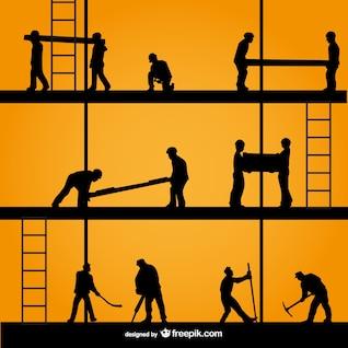Siluetas de trabajadores de construcción
