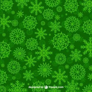 Patrón de copos de nieve verdes