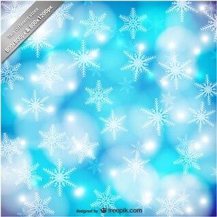 Fondo azul y blanco con copos de nieve