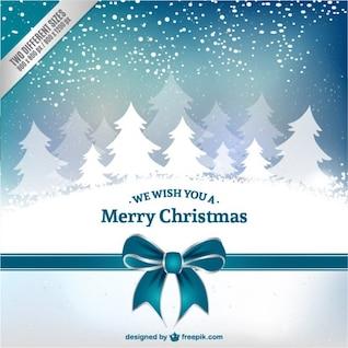 Tarjeta de Navidad con los árboles blancos
