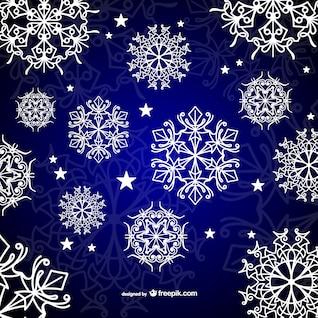 Fondo con los copos de nieve blancos caligráficas