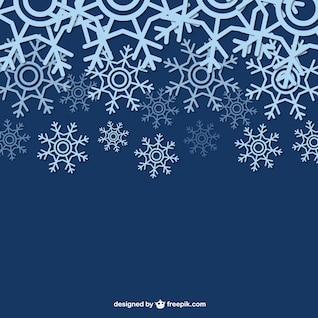 Fondo del invierno con los copos de nieve