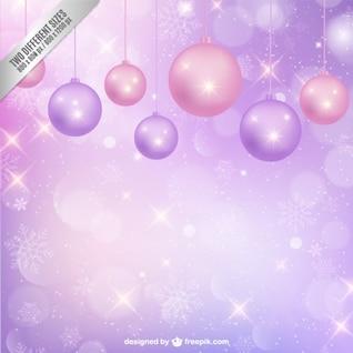 Fondo violeta y rosa con adornos de navidad