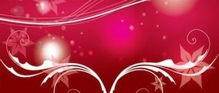 Elementos florales sobre fondo de color rosa