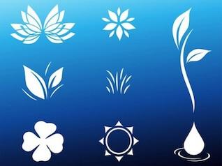 Flores formas y gota de agua sobre fondo azul